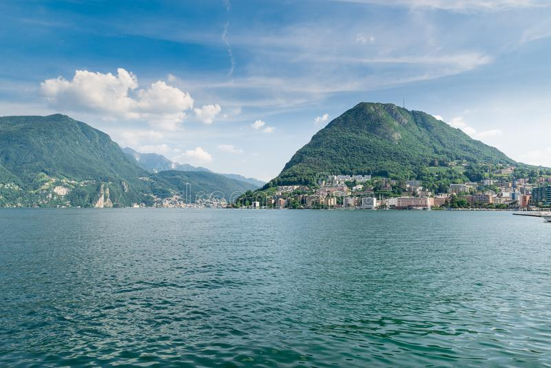 Lugano, Canton Ticino, Switzerland. Lugano lakefront and Lugano lake with the San Salvatore mountain in summer royalty free stock photo