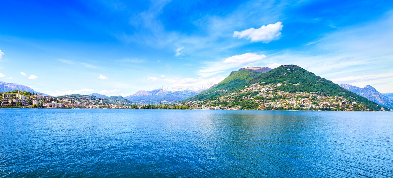 Lugano Lake panoramic landscape. City and mountains. Ticino, Swiss, Europe stock photo