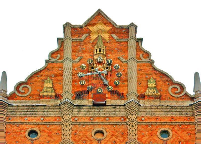 LUGANSK, UCRÂNIA - 1 DE DEZEMBRO DE 2012: O relógio na torre frontal do Hotel 'Ucrânia' imagem de stock royalty free