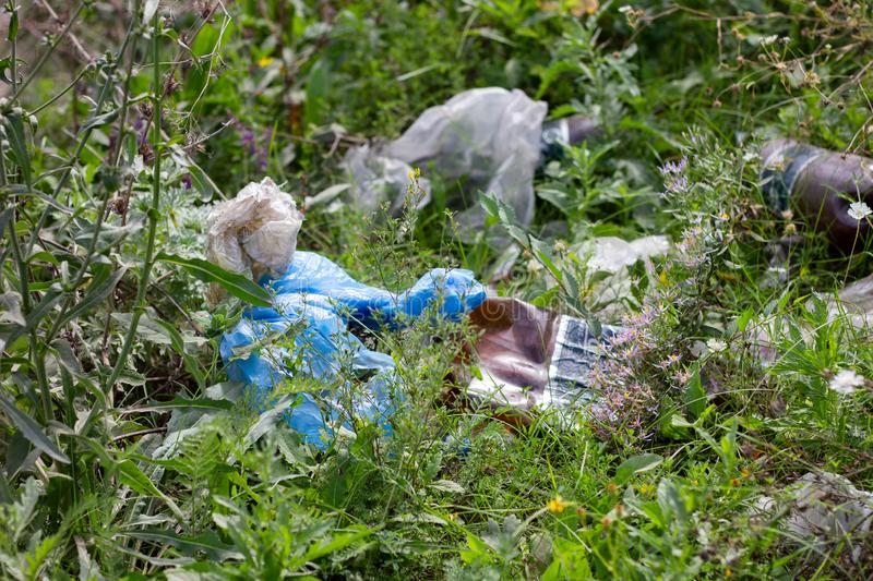 LUGANSK , UKRAINE 7 Sep - 2019 : Discarded on the roadside trash , the urban environment pollution.  royalty free stock photos