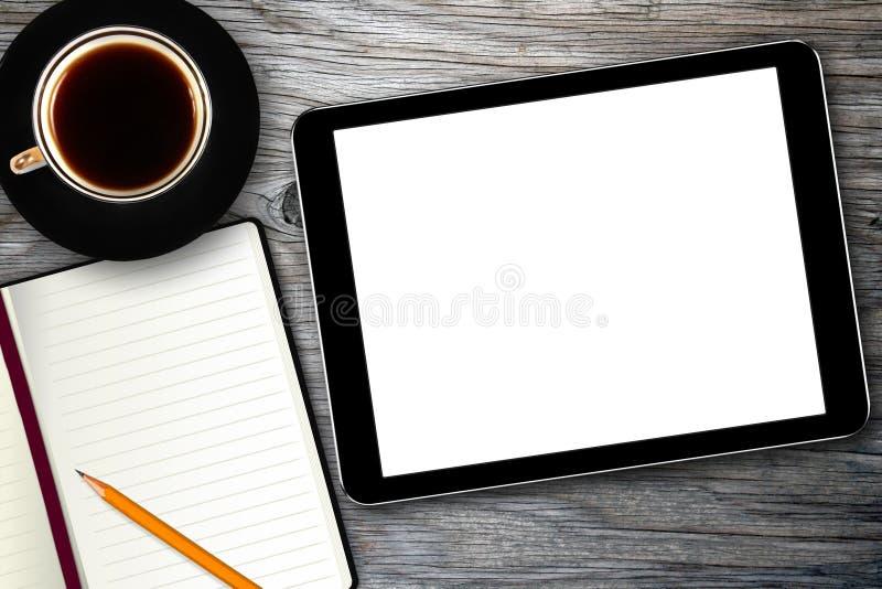 Lugar de trabajo con la taza digital de la tablilla y de café imagen de archivo