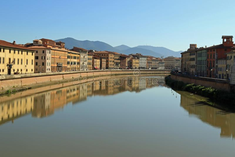 Lugarno Sidney Sonnino, Pisa. Lugarno Sidney Sonnino reflected in the river Arno on a September morning, Pisa, Italy royalty free stock photos