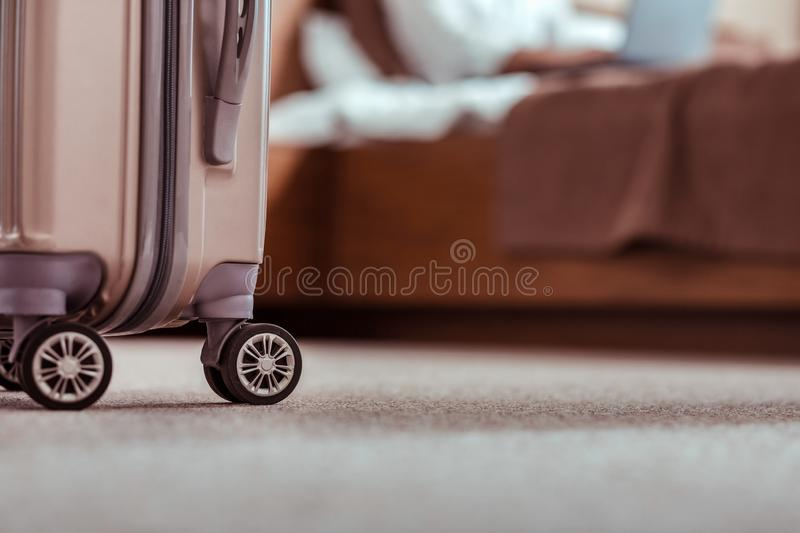 Luggage bag being prepared for leaving from a hotel room stock photos