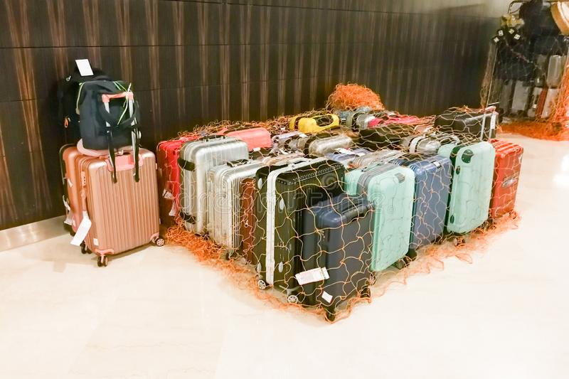 Luggage bags at hotel concierge isolated and secured with netting stock image