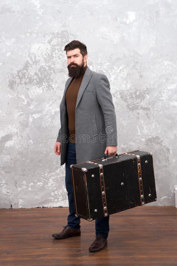 Luggage insurance. Man well groomed bearded hipster with big suitcase. Travel and baggage concept. Hipster traveler with. Baggage. Ready for relocation with royalty free stock images