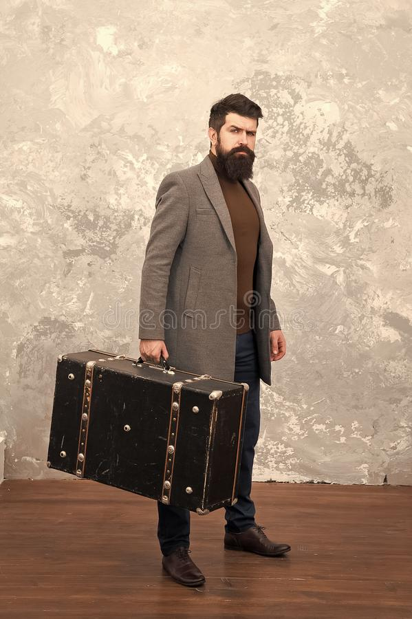 Luggage insurance. Man well groomed bearded hipster with big suitcase. Travel and baggage concept. Hipster traveler with. Baggage. Ready for relocation with royalty free stock photo