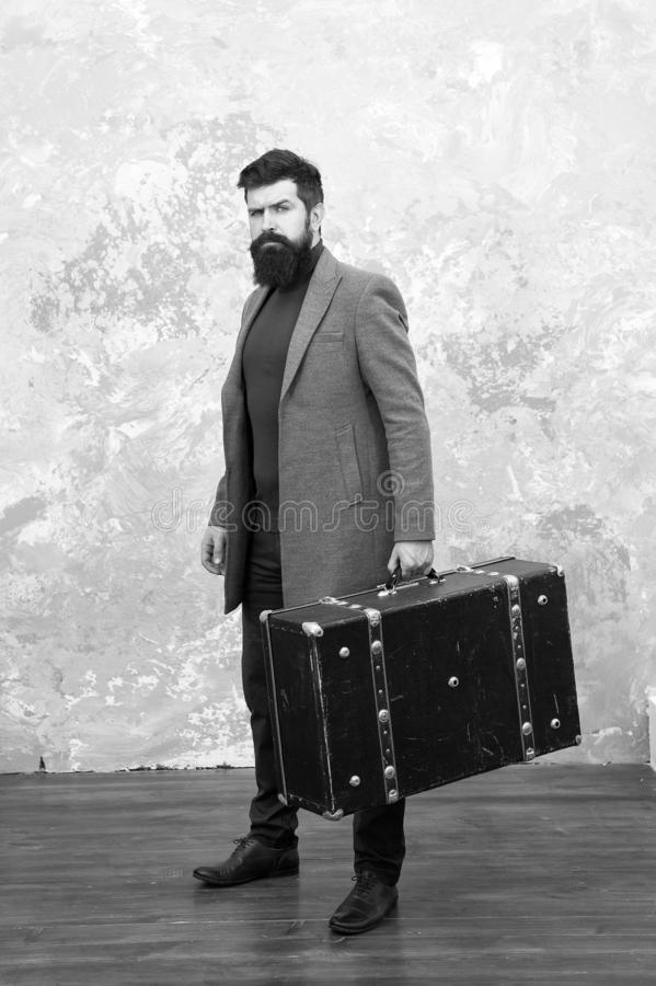 Luggage insurance. Man well groomed bearded hipster with big suitcase. Travel and baggage concept. Hipster traveler with royalty free stock photography