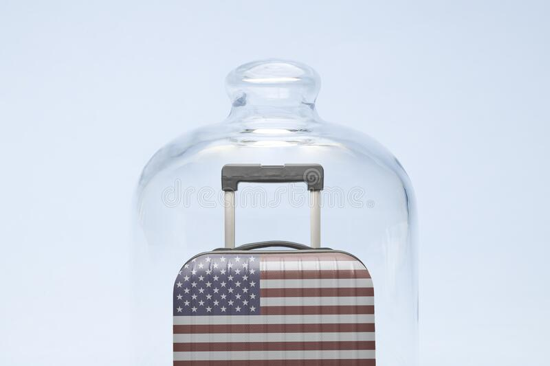 Luggage in isolation under glass cover covid-19 tourism united states of america abstract. Suitcase with united states flag design in quarantine minimal creative stock photography