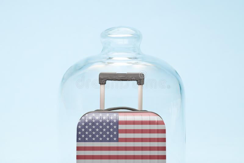 Luggage in isolation under glass cover covid-19 tourism united states of america abstract. Suitcase with united states flag design in quarantine minimal creative royalty free stock image