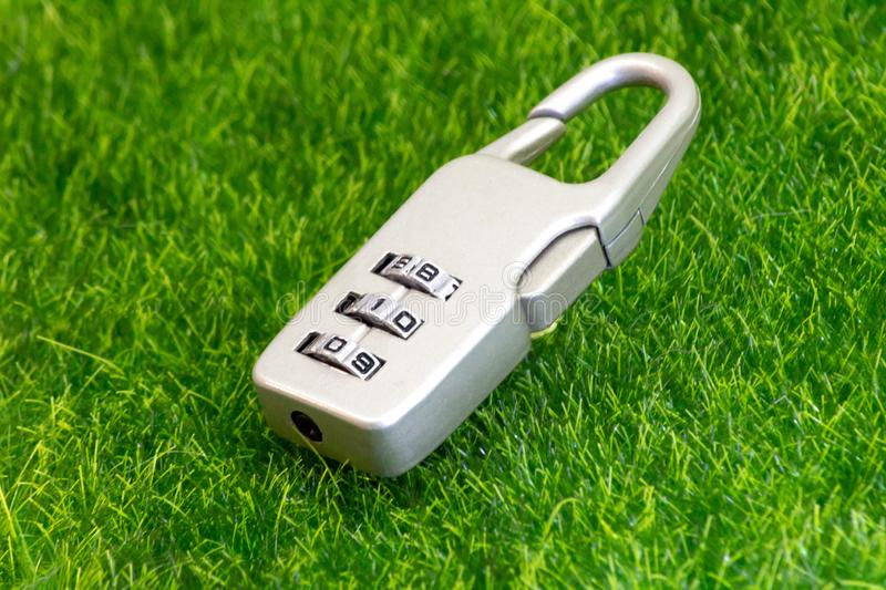 Luggage lock for baggage travelers on green grass. stock image