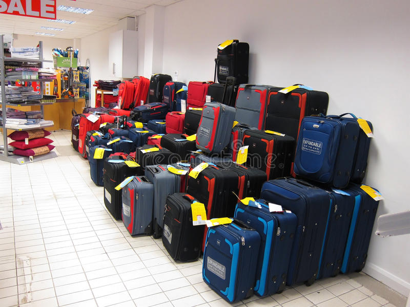 Luggage for sale on display. A display of cases and trunks on display in a store. Various sizes and colors are stacked up for sale royalty free stock photo
