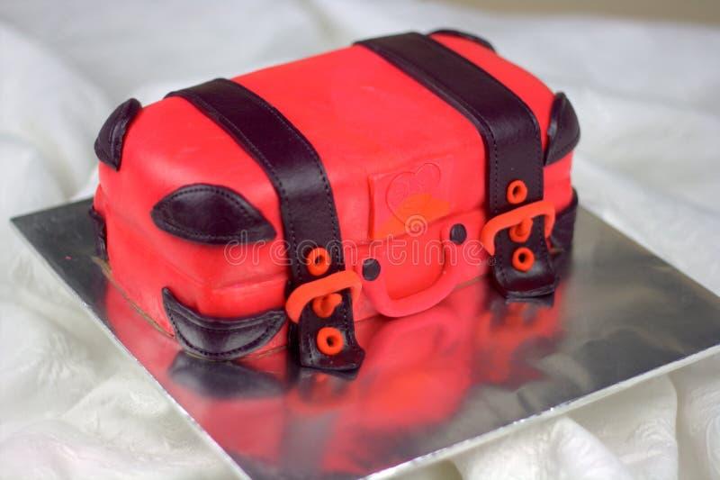 Luggage shaped fondant cake red and black. Luggage shaped fondant cake with red and black color. Bon Voyage theme, farewell cake stock photos
