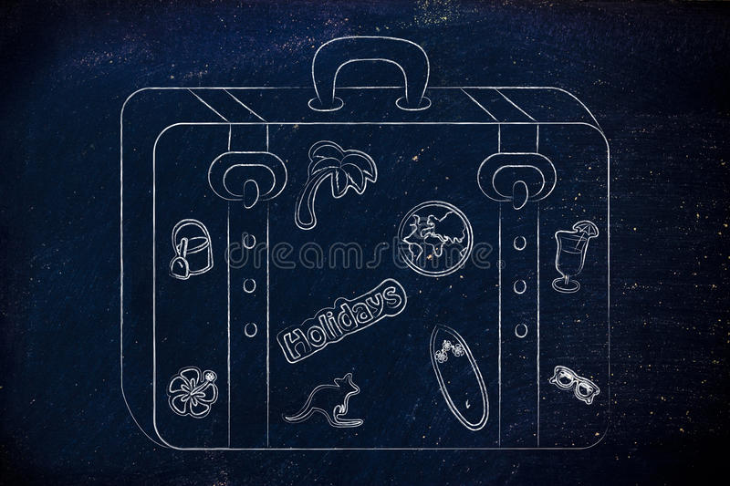 Luggage with summer holiday inspired stickers royalty free stock images