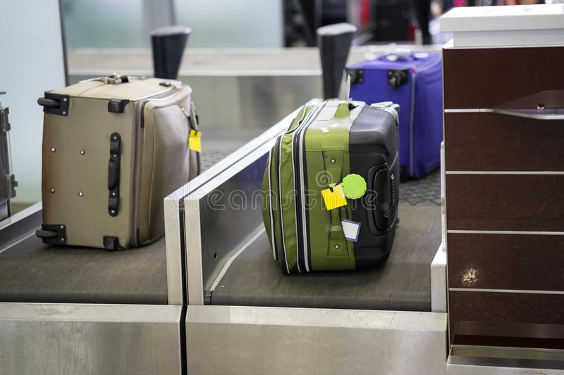 Luggage on weight at check-in counter at airport stock photos