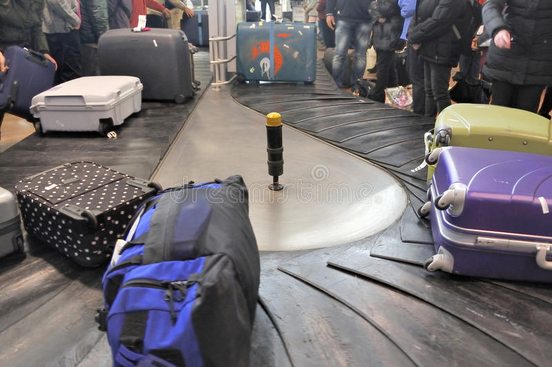 Luggages moving on baggage belt royalty free stock images