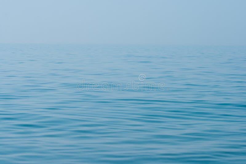 lugnat surface vatten för horisonthavhav fortfarande arkivbilder