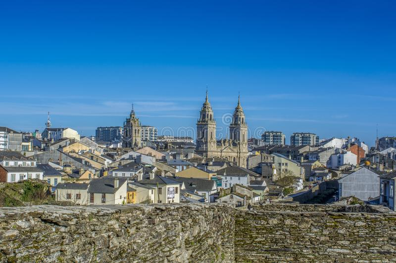 Cathedral towers protruding from the walled town of Lugo royalty free stock photography