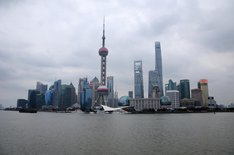 Lujiazui Skyline shanghai. The Lujiazui skyline on a gray, overcast stormy day as seen across the Huangpu River in Shanghai China stock photos