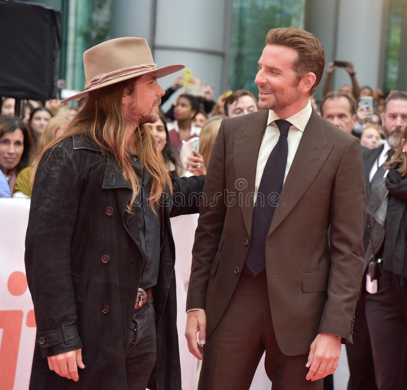 Lukas Nelson and Bradley Cooper on the red carpet for `A Star Is Born` premiere during TIFF2018. Country musician Lukas Nelson and director Bradley Cooper on the royalty free stock photography