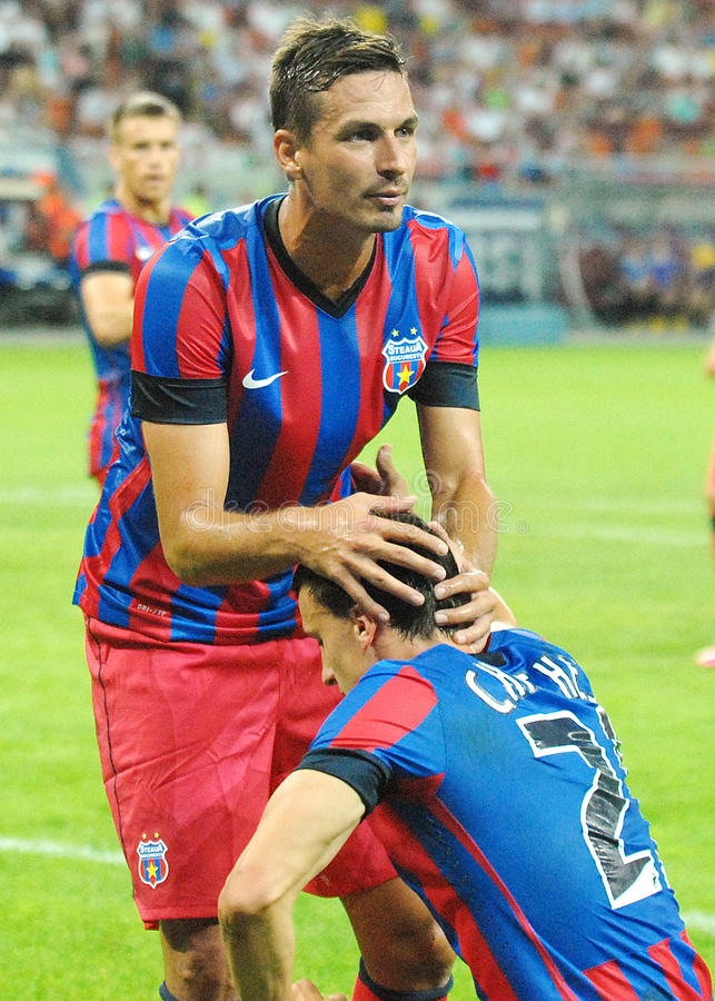 Lukasz Szukala and Vlad Chiriches. Vlad Chiriches and Lukasz Szukala of Steaua Bucharest, pictured in action during the Romanian SuperCup between Steaua royalty free stock image