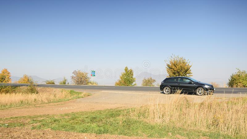 Lukavec, Czech republic - October 13, 2018: black car Opel Astra near road 247 and Lovos hill on background in Czech central mount. Ains stock photo