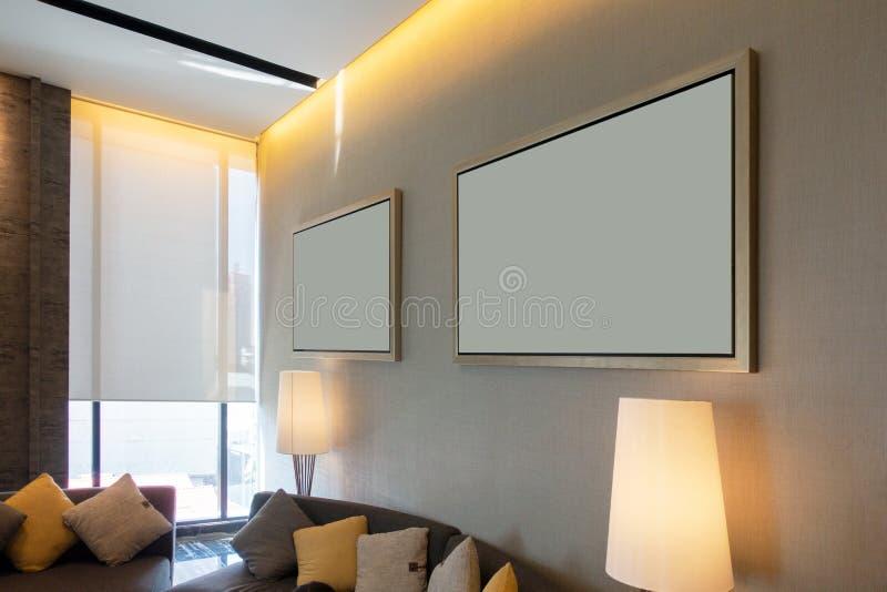 Luksusowy nowożytny żywy pokój z obrazek ramami i kanapy dekoracją, Domowy wewnętrznego projekta tło obraz stock