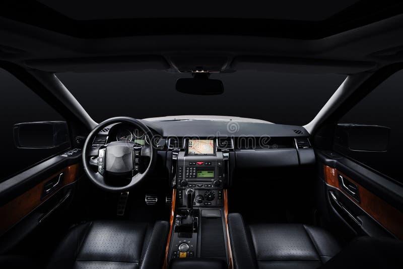 Luksusowy samochodowy rzemienny wnętrze, czarny pracowniany tło fotografia stock