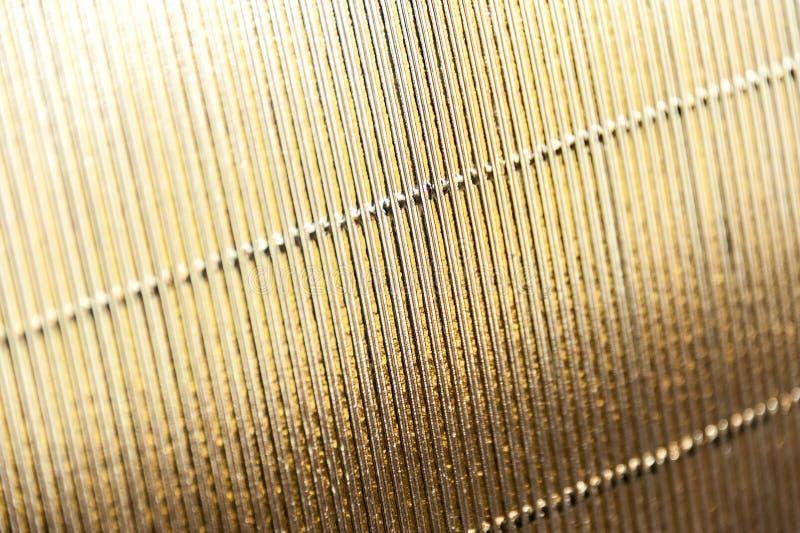 Luksusowy złoto gofrował papierową teksturę dla tła, abstrakcjonistyczny złoty wzór obrazy stock