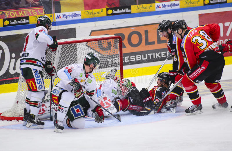 Lulea, Sweden - March 18, 2015. Karl Fabricius (#52 Lulea Hockey) slides with full speed into opponents goalie. Swedish Hockey Le stock photo
