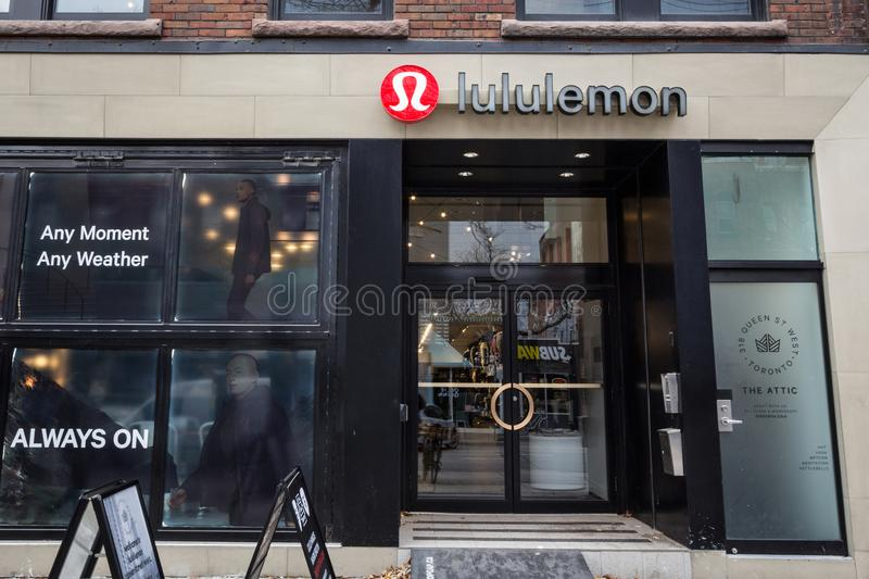 Luluemon Athletica logo in front of their local store in downtown Toronto, Ontario. TORONTO, CANADA - NOVEMBER 13, 2018:  Lululemon is a Canadian Athletic and royalty free stock image