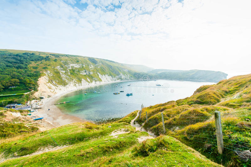 Lulworth Cove. Famous Lulworth Cove, part of the Jurassic Coast in Devon and East Dorset, southern England stock images