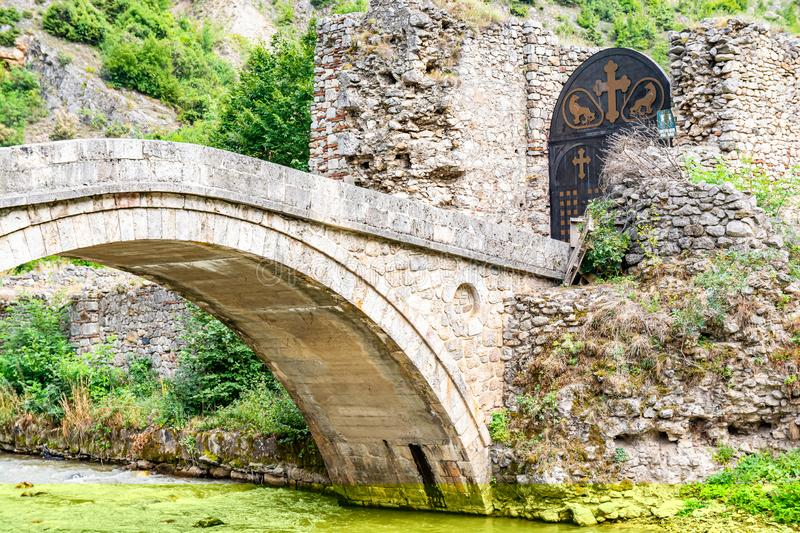 Lumbardhi, Kosovo - July 28, 2019. Old bridge and gate to Monastery of the Holy Archangels.  royalty free stock photo