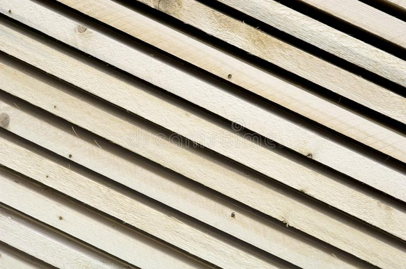 Lumber industry - Saw mill - yard of finished lumber. Background from structure of stocked wood planks royalty free stock image