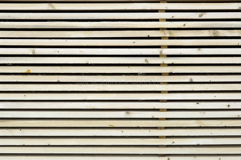 Lumber industry - Saw mill - yard of finished lumber. Background from structure of stocked wood planks stock photography