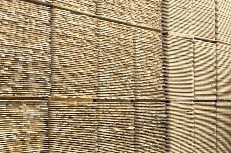 Lumber industry - Saw mill - yard of finished lumber. Background from structure of stocked wood planks stock photo