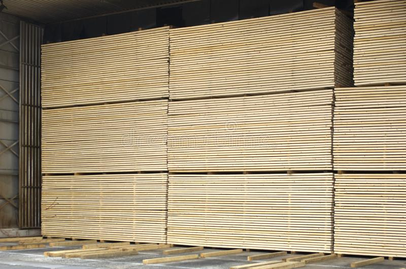 Lumber industry - Saw mill - yard of finished lumber. Background from structure of stocked wood planks royalty free stock photography