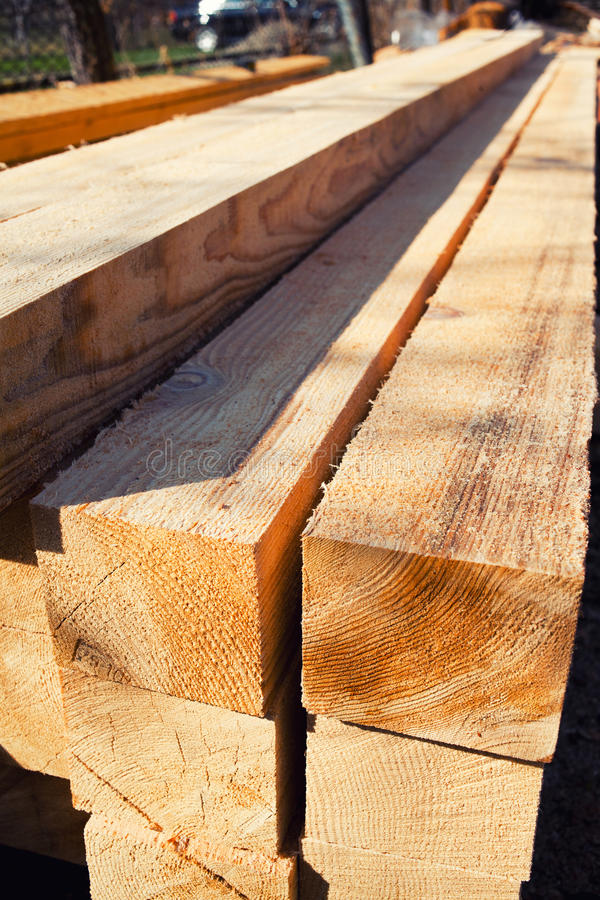 Lumber stack. For construction, piled up outdoors royalty free stock photo