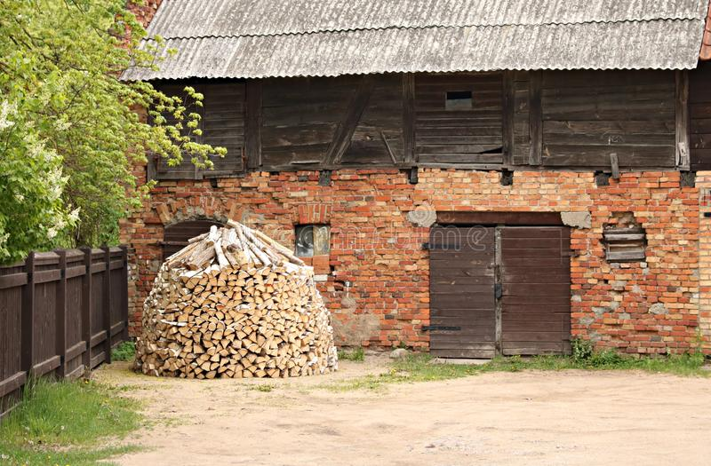 Lumbered chopped firewood for the winter and piled in stacks near the hut. Kuldiga, Latvia May 11, 2019.  royalty free stock images