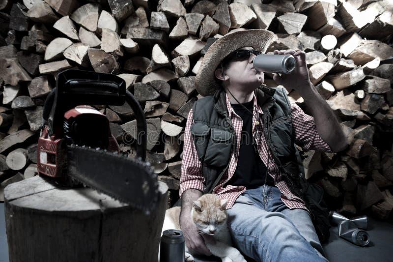 Lumberjack с цепной пилой стоковые фотографии rf