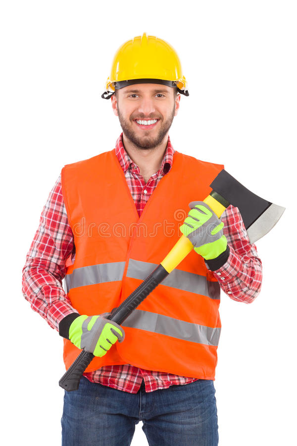 Lumberjack with an axe. Smiling lumberjack in yellow helmet and orange waistcoat posing with an axe. Waist up studio shot isolated on white royalty free stock photo