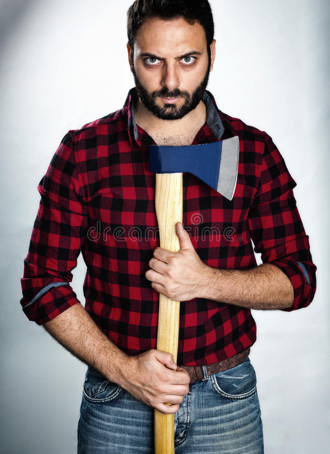 Lumberjack with dark style. Lumberjack with plaid shirt in dark style royalty free stock images