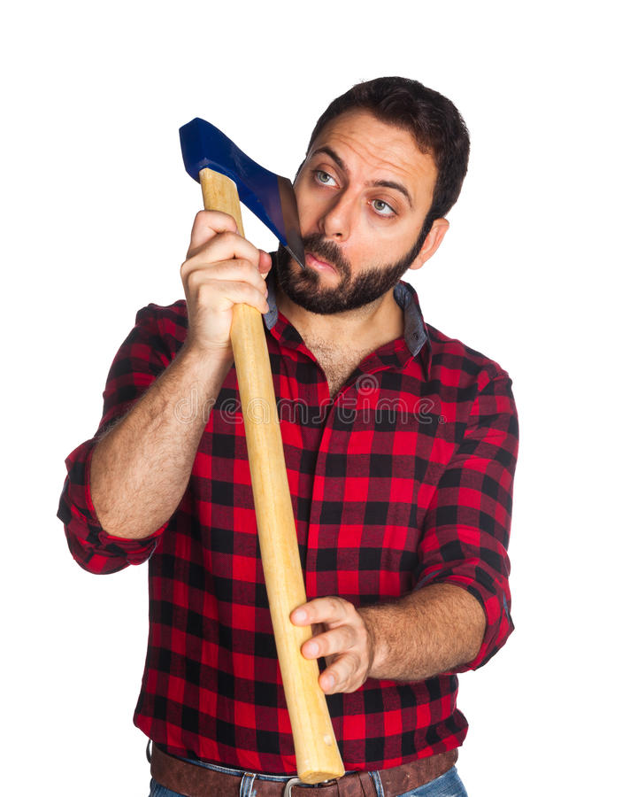 Lumberjack shaves his beard with the ax blade. Lumberjack with plaid shirt shaves his beard with the ax blade on white background royalty free stock photos