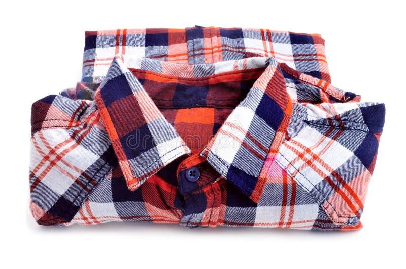 Lumberjack shirt. A folded lumberjack shirt on a white background stock image