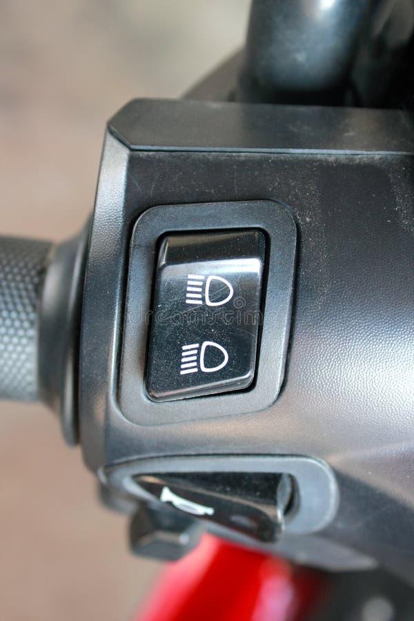 Lumière élevée, faible luminosité sur la moto photo stock