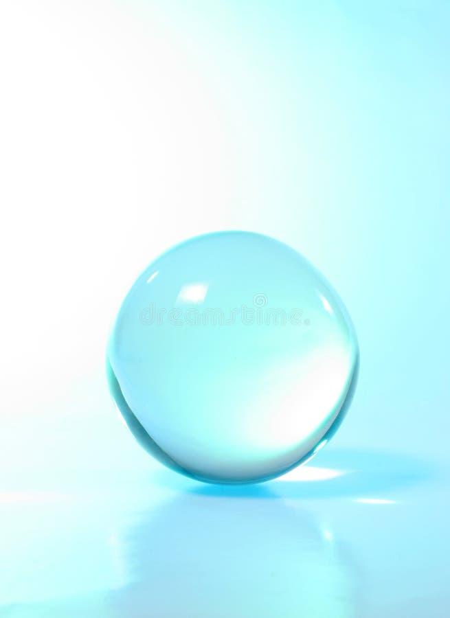 Lumière de turquoise de bille en cristal photos libres de droits