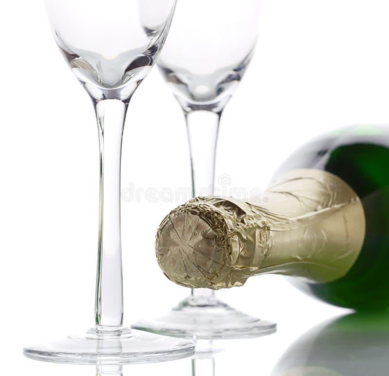 Lumière principale élevée de bouteille de Champagne photos stock
