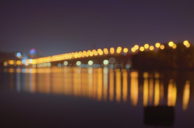 Lumières abstraites urbaines Defocused de ville de bokeh de texture à l'arrière-plan avec les lumières de flou pour votre concept photos stock