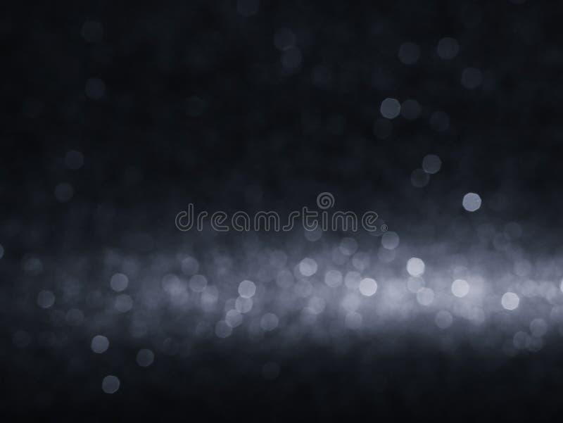 Lumières brouillées brillantes de bokeh de backgroun de lumières de glister de bokeh de fond de concept de l'espace noir abstrait image libre de droits