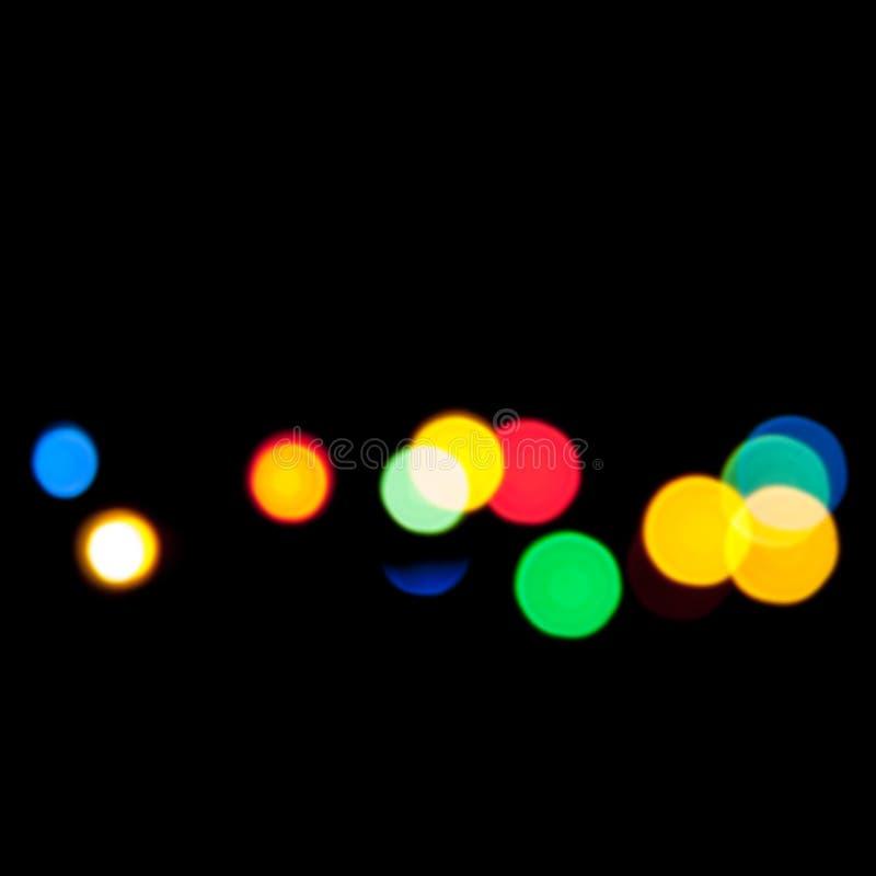 Lumières brouillées colorées au-dessus de noir image libre de droits
