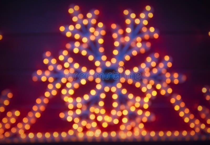 Lumières brouillées de flocon de neige de Noël photographie stock